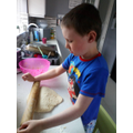 Joshua rolling out his scones