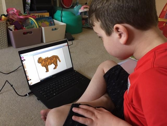 Charlie using Purple mash to create a tiger