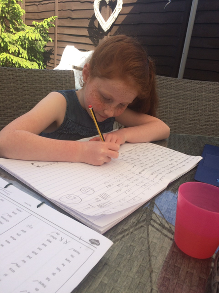 Busy writing in the sun!