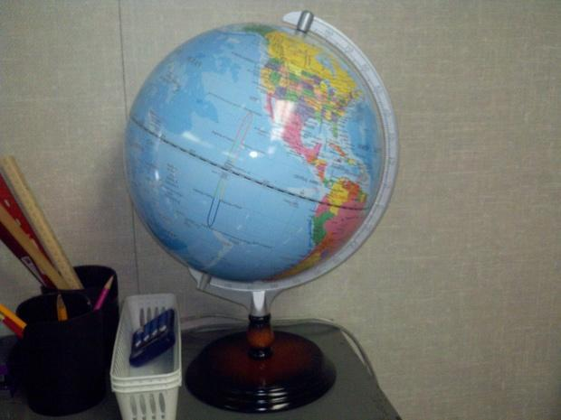 The globe in the classroom is a sphere