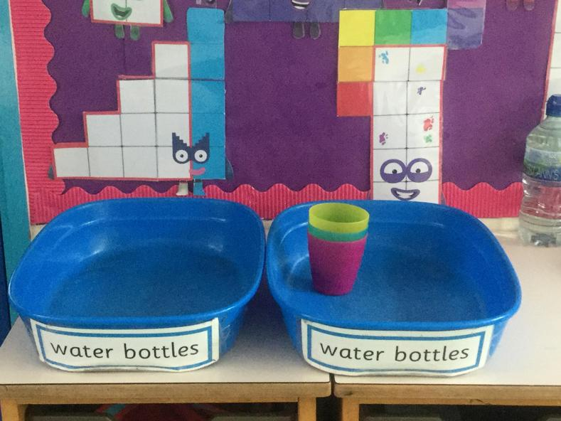 We keep our water bottles in these trays so that they are always accessible