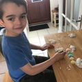Kyan painting his glow in the dark space magnets