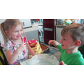 Blake and his sister making chocolate apples