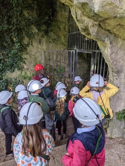 Entering the cave with our safety helmets and headlamps or torches.