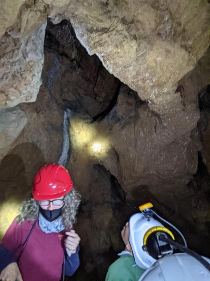 Examining the stalactites made of calcium..