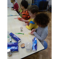 Decorating biscuits with spotts for Pudsey!