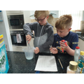 Science experiment with careful measuring