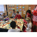 Y1 giving their gingerbread people red noses!