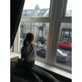 Maddison helping to clean the windows