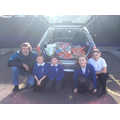 Year 6 children helping to load our donations