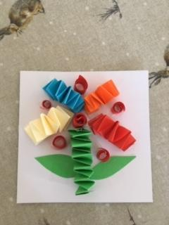 Evelyn created this beautiful rainbow flower.