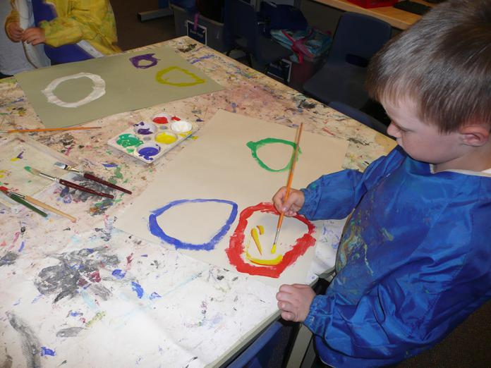 First we painted a large, colourful circle.