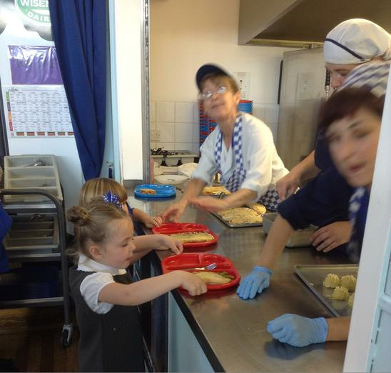 collecting our hot school meal