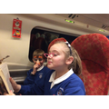 The crazy pair entertain themselves on the train!!