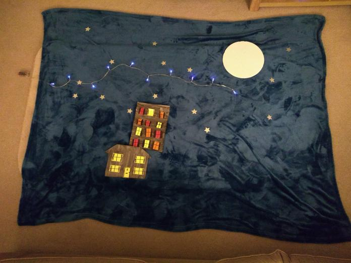 Emily's (2PM) spectacular moonlight scene using a blanket, fairy lights and other bits 🤩