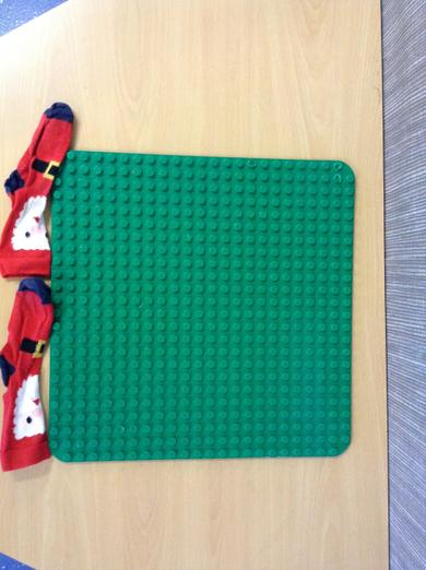 A lego board is 2 socks long