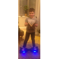 Jacob reading on a hover board!!