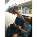 Reading with Granny at Cagliari Station, Sardinia