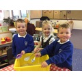 Reception children mixing magic reindeer dust!