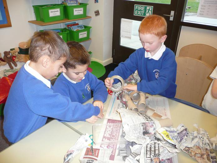 Working as a team to build rockets.