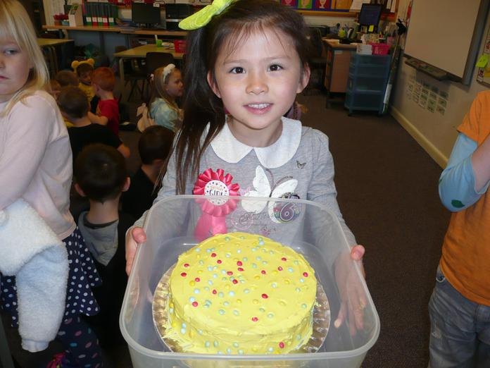 Alice was a runner up in the cake competition.