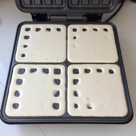Pour batter into waffle moulds. Don't overfill.