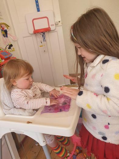 Sisterly love 🥰 Exploring with sensory mats.