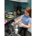 Jessica helping with the dishwasher!