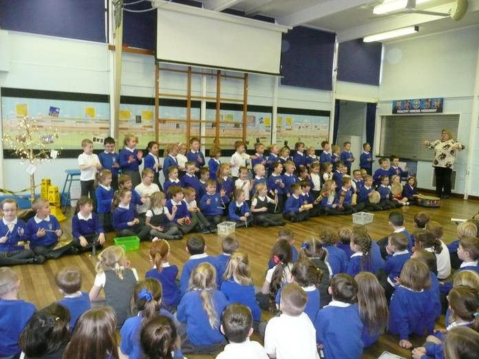 Year 2 perform their poems to Year 1 and Reception