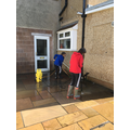 Izzie cleaning the patio!
