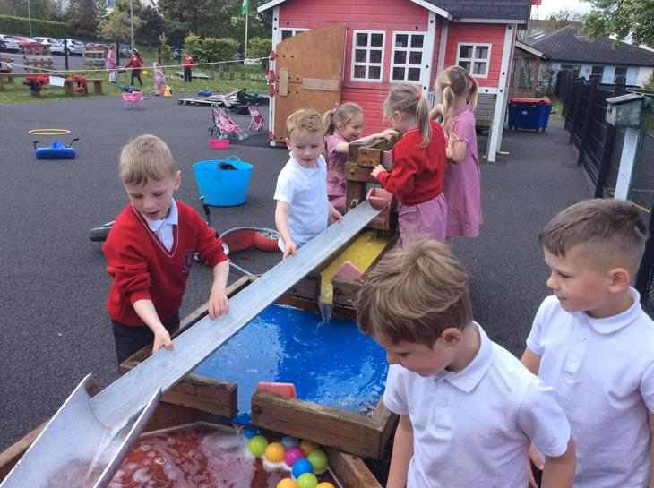 Outdoor water tray challenge fun.