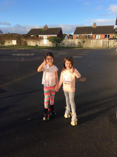These girls enjoyed rolling to school!