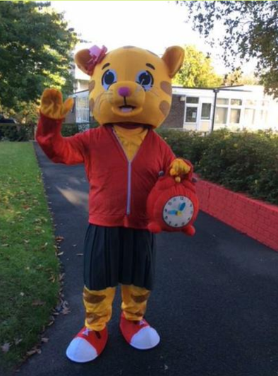 COTAT the tiger reminds children to be on time!