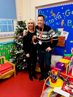 Mrs Totty and Mr Rees in their festive jumpers!