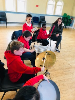 We love playing the different instruments!