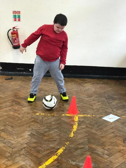Dribbling in and out of the cones