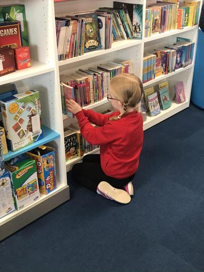 Choosing a book on our fortnightly library trip