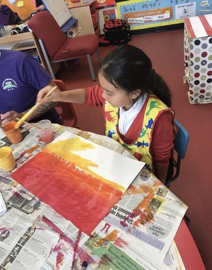 Painting a sunset for our work on the Lion King