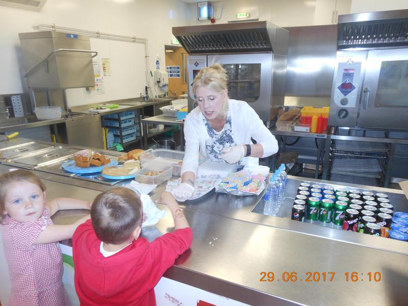 Mrs James helping to serve in the cafe