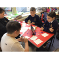 We are designing and making Microbe Top Trump cards.