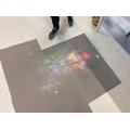 We threw powder paint onto black paper!