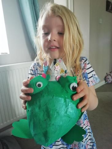 O has made a papier mache frog