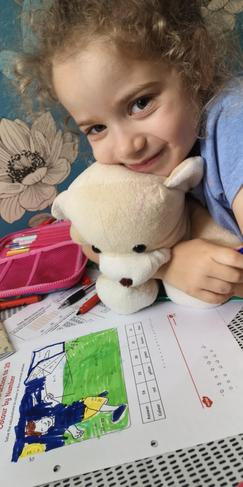 TA learning with a cuddly friend.