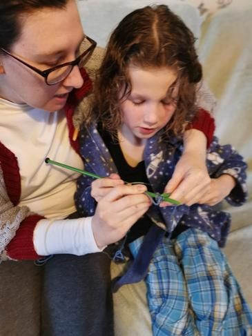 E, learning to knit.