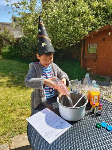 Wizard E mixing potions for his Maths challange