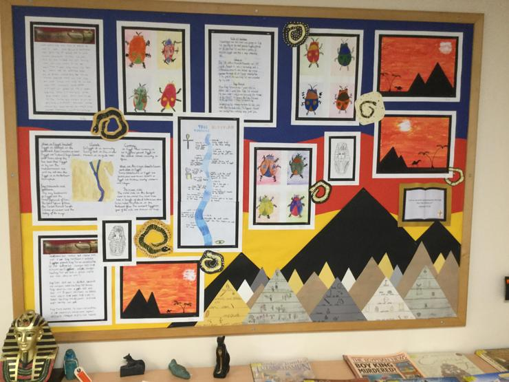 Year 6 children used a watercolour wash for the background of their Egyptian pictures.