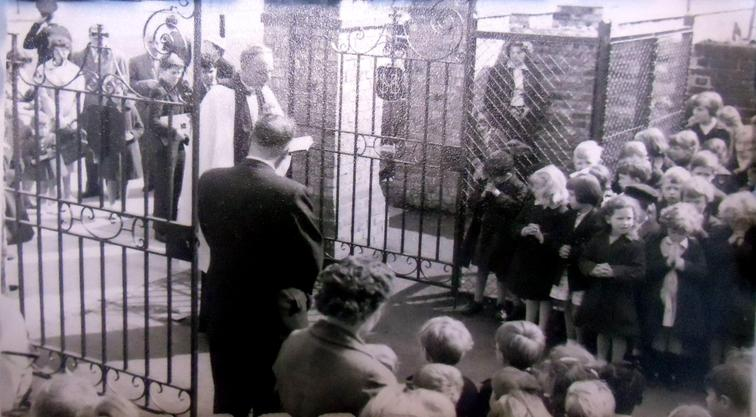 Centenary Gates being blessed by St Mary's vicar.