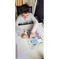 Kieron playing a maths game
