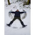Kieron making a snow angel