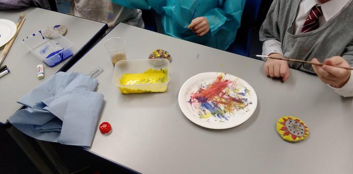We used primary colours, and mixed them to make secondary colours like purple and green!